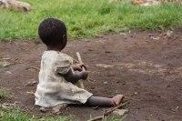African baby in dirt