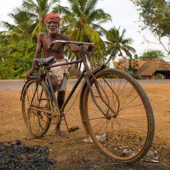 Old Man Wearing Turban Posing With His Rusty Bike By The Wayside, Pondicherry, India